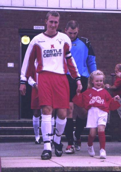 Jimmy Harrison leads out the Team